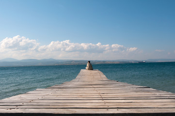 old wooden jetty and a man