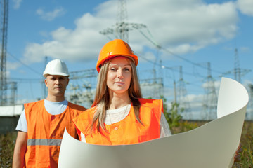 two workers wearing protective helmet