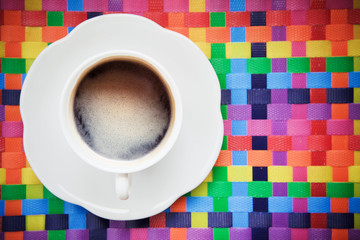 hot coffee and white cup on colorful background