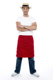 Stylish chap wearing hat. Apron tied on his waist poster
