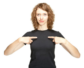 Portrait of young woman pointing on herself