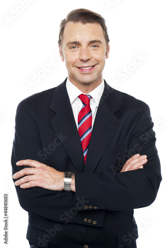Arms crossed portrait of caucasian businessman