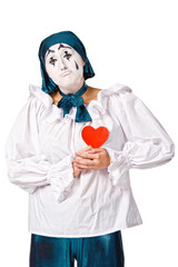 sad female mime clown with a red heart
