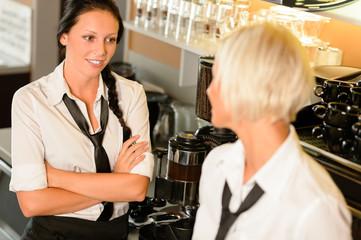 Waitresses talking gossiping in break cafe women