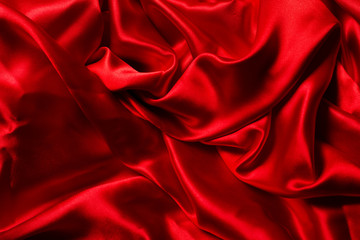 Red silk background. A lot of crumpled folds