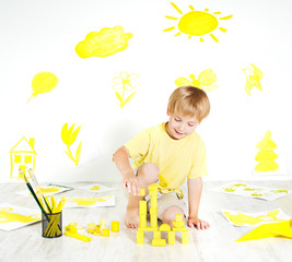 Child playing with construction blocks. Development and creativi