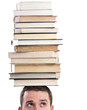 Man with books on his head