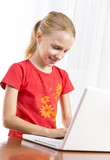 Cute girl playing on the laptop