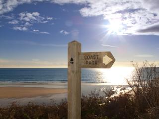 Sign post for coast path near beach, Gerrans Bay, Cornwall, United Kingdom