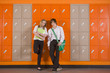 Students leaning on school lockers