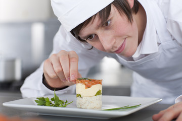 Trainee chef working in commercial kitchen
