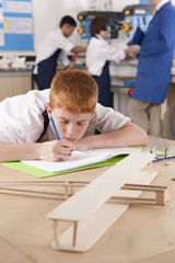 Student working on model airplane in woodworking class