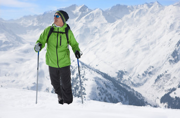 Man hiking on mountain top in snow