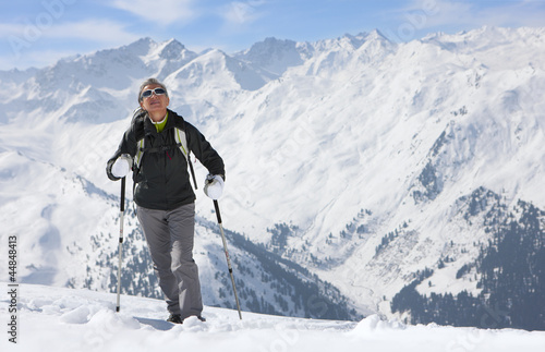 Woman hiking on mountain top in snow