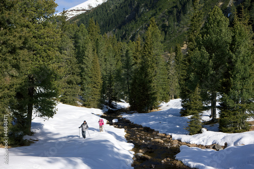 Couple exploring snow covered wilderness