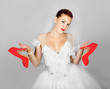 Portrait of young beautiful bride with  red shoes