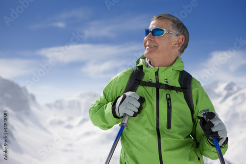 Man hiking up ski slope on mountain