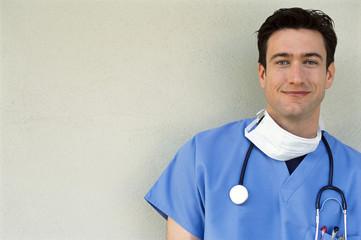 Portrait of smiling doctor in scrubs