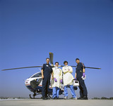 Portrait of doctors and paramedics outside emergency airlift helicopter