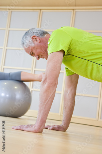 Senior man exercising in gym