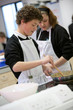 Students cooking in home economics class