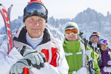 Close up portrait of smiling senior couples with skis