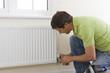 Handyman fixing radiator