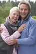 Portrait of smiling senior couple hugging