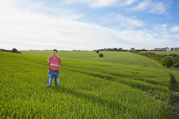 Portrait of farmer with arms crossed in wheat field