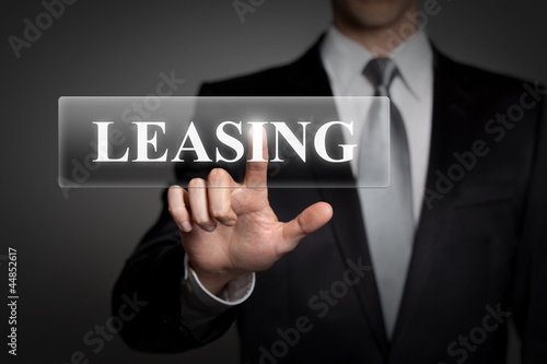 businessman pressing touchscreen button - Leasing