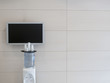 Television monitor on wall near water cooler in office