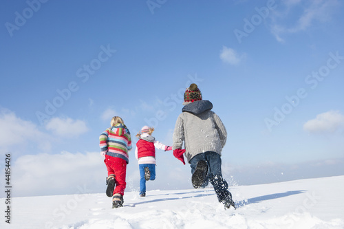 Boy and girls running in snow