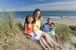 Portrait of smiling family on sunny beach