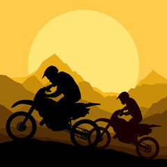 Motorbike riders motorcycle silhouettes in wild mountain landsca