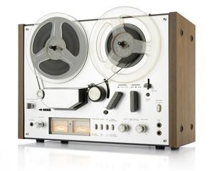 vintage analog recorder reel to reel on white background