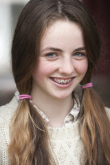 Close up portrait of smiling girl with braces and pigtails