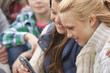 Teenage girls viewing text message on cell phone