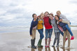 Portrait of smiling teenage girls on beach