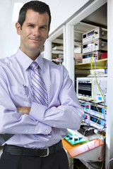 Portrait of confident, businessman in silicon wafer manufacturing laboratory