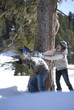 Couple having snowball fight outdoors