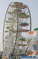 wheel with baskets and carriages in an amusement park