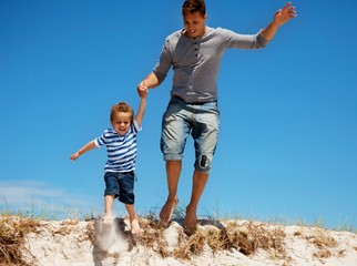 Father and Son Jumping Outdoors