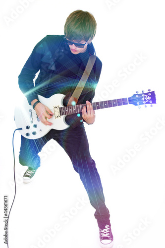 Portrait of young rocker posing in studio on white background in