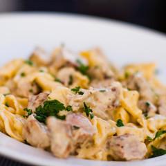"""Italian pasta """"tortellini con filetti di maiale"""" closeup"""