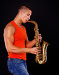A young man is playing saxophone
