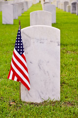 row of tombstones with an american flag