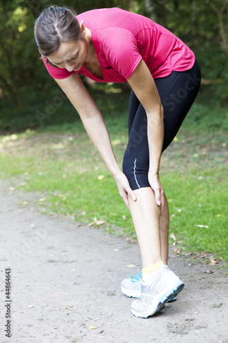 woman having cramp while running