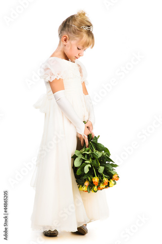 beautiful upset little girl with flowers isolated over white