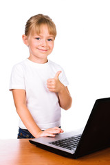 Portrait of a smiling girl touching laptop with thump up sign is