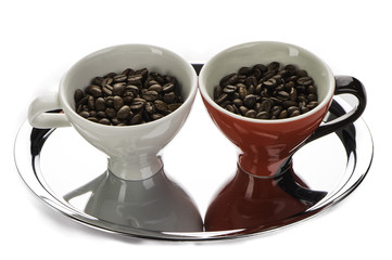 Two coffee cup with beans